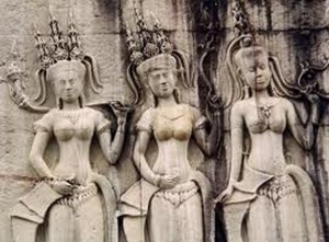 Apsara dancers are carved on walls in Angkor Wat temple
