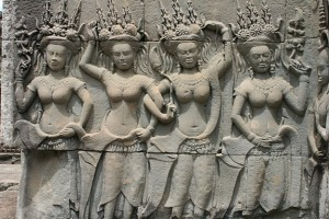 Apsara dancers on walls within the Angkor temple