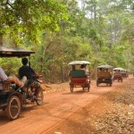 Travelling between temples at Angkor by tuk-tuk along the dusty roads during dry season
