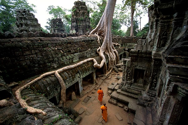 Photo of Buddhist monks walking through Angkor Wat