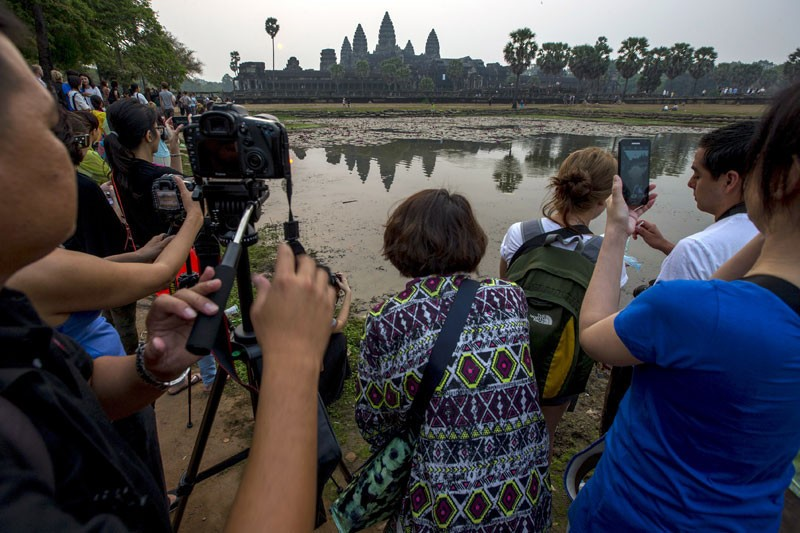 Tourists take photo of Angkor Wat