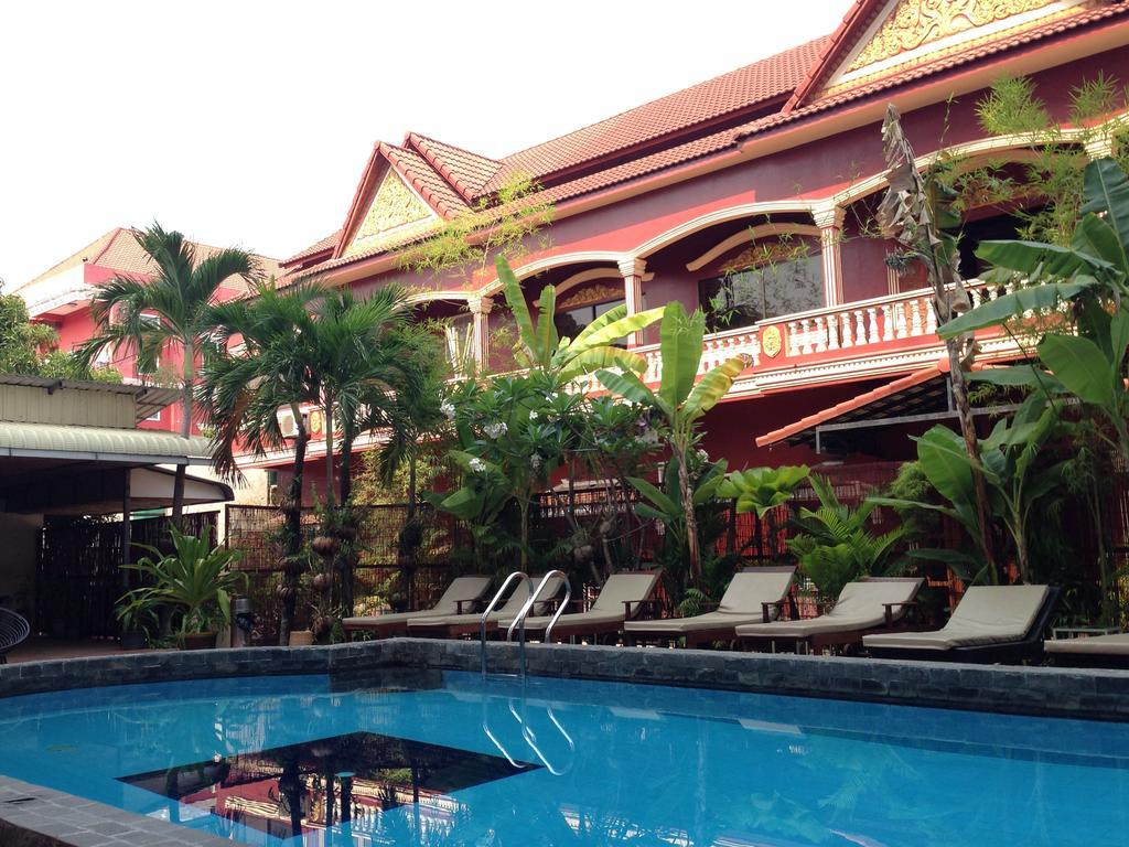The outside swimming pool of Angkor Palace Resort & Spa hotel
