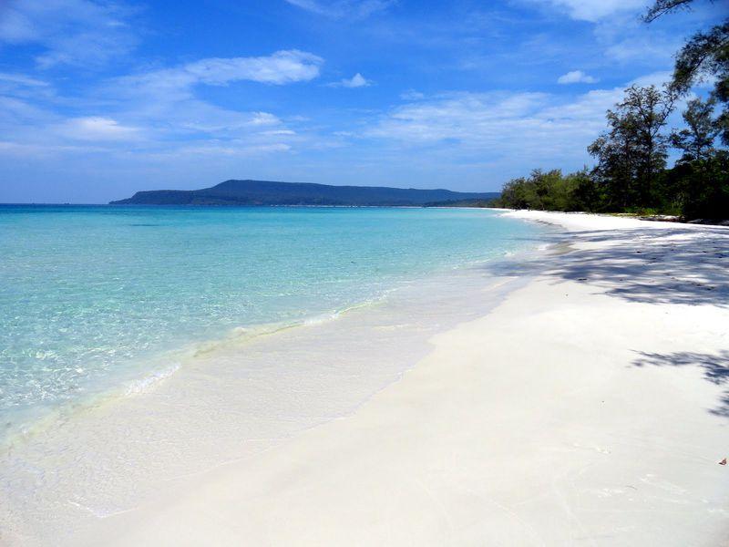 The long white sand glittered by summer's sunshine