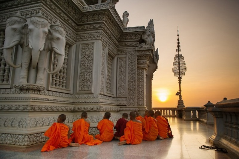 Buddhist Monks Praying at Sunset in Oudong, Cambodia
