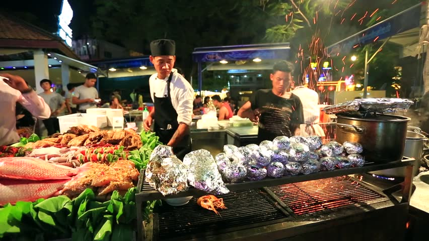 A chef cooking in Siem Reap's Pub Street