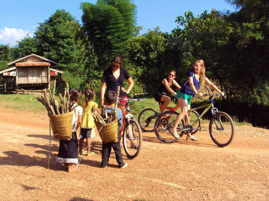 Cycling and meet local kids