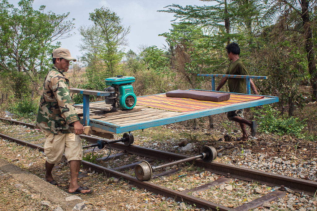 The drivers disassembling a bamboo train