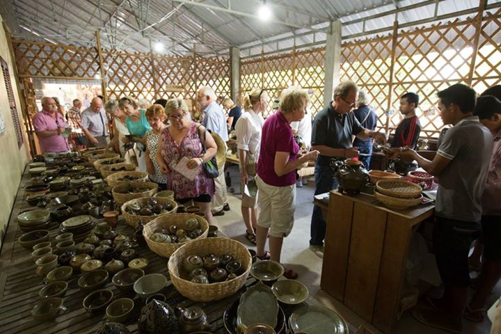 Travelers are visiting Kampong Chhnang Pottery village