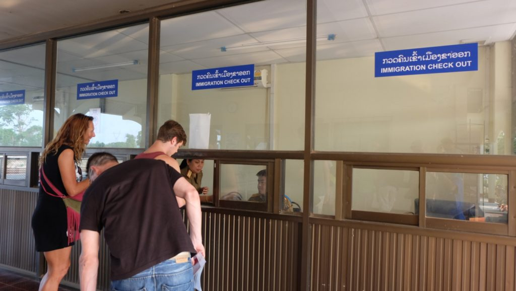 You can exchange money at immigration Laos