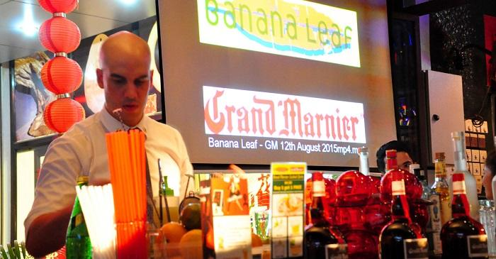 A mixologist is performing at a corner of Banana Leaf restaurant